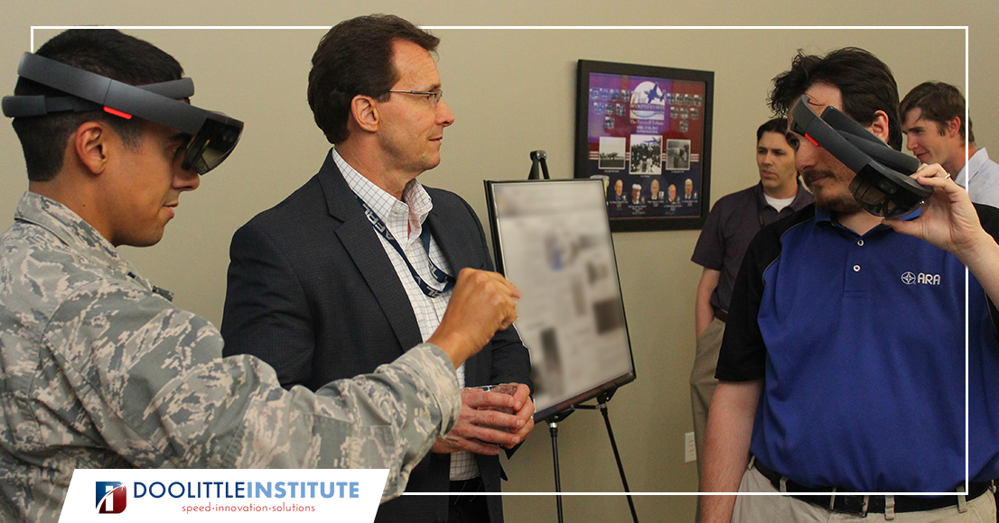 Two members of AFRL review a technology.