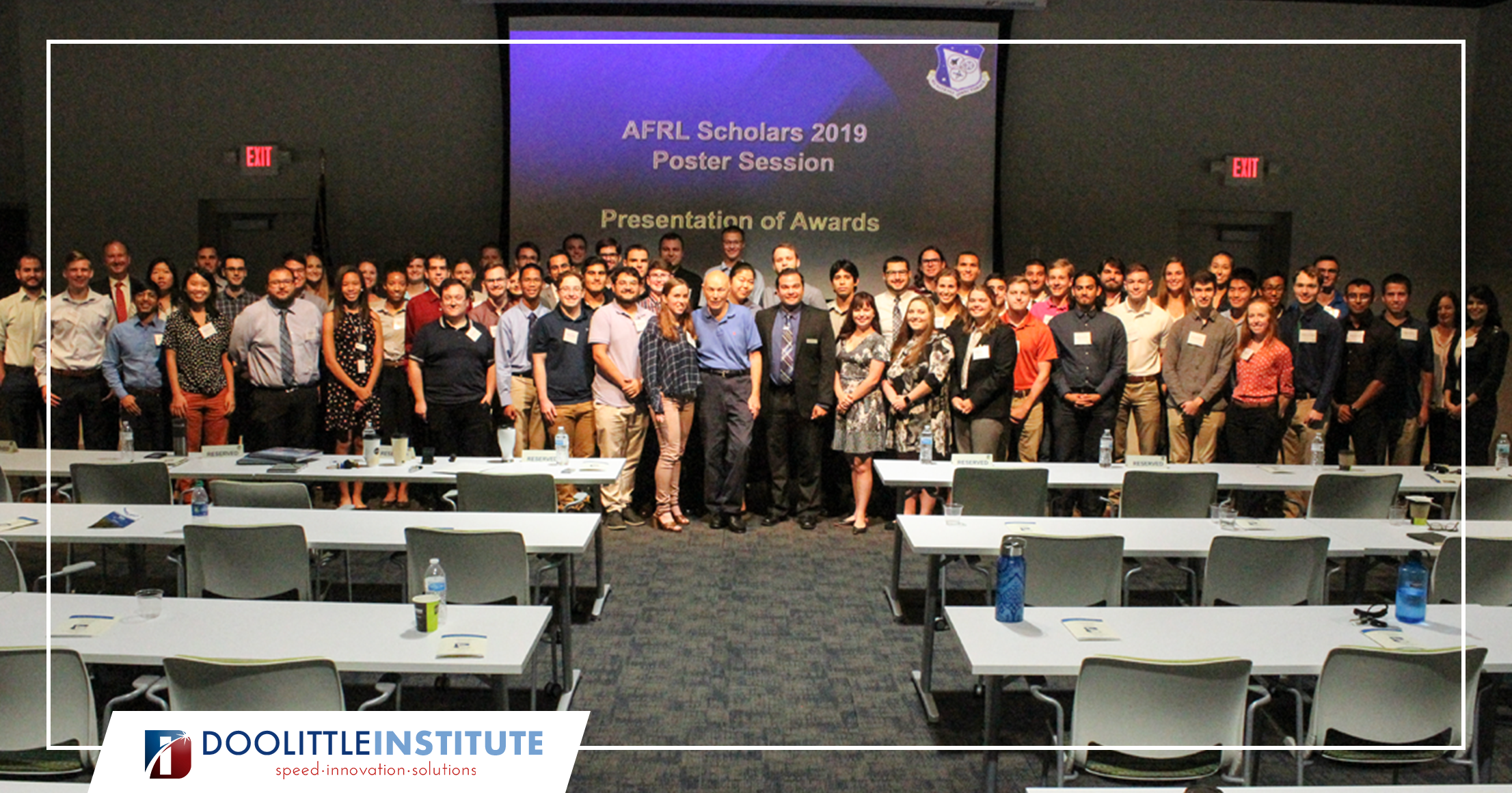 Dr. Story Musgrave poses with all 63 of the AFRL Scholars. Photo by the Doolittle Institute.