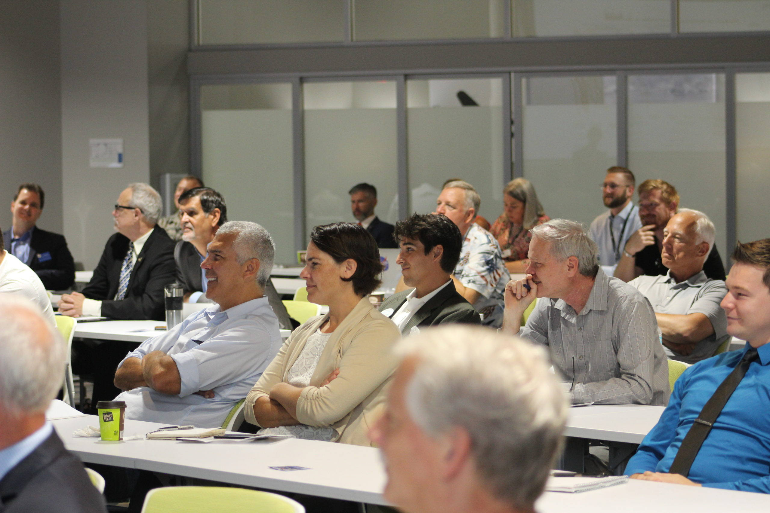 People sitting at event held at the Doolittle Institute
