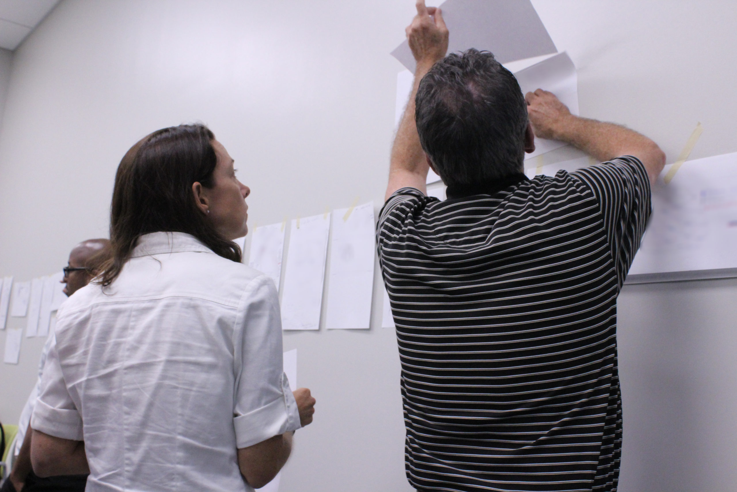 Researchers writing on paper at the Doolittle Institute